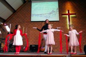 Schinnen, the Netherlands - April 20, 2014: Children are dancing on Easter day in the local Church. As you can see they are very concentrated in this Service of Celebration.